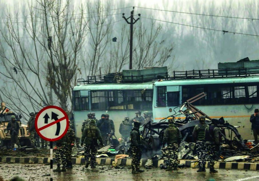 Lathepora: Security personnel carry out the rescue and relief works at the site of suicide bomb attack at Lathepora Awantipora in Pulwama district of south Kashmir, Thursday, February 14, 2019. At least 30 CRPF jawans were killed and dozens other injured when a CRPF convoy was attacked. (PTI Photo/S Irfan) (PTI2_14_2019_000167B)