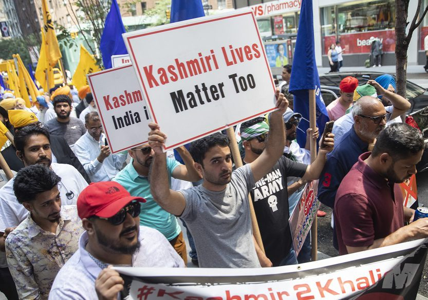Kashmiris and pro Khalistan Sikhs demonstrate during a march and rally to protest Indian Prime Minister Narendra Modi's decision to strip Kashmir of its special status and the continuous occupation of Punjab, Thursday, Aug. 15, 2019, in New York. Modi on Thursday used an Independence Day speech to defend his decision to strip Kashmir of its special status as about 7 million residents of the disputed region endured an unprecedented security lockdown and communications blackout for an 11th day. (AP Photo/Mary Altaffer)