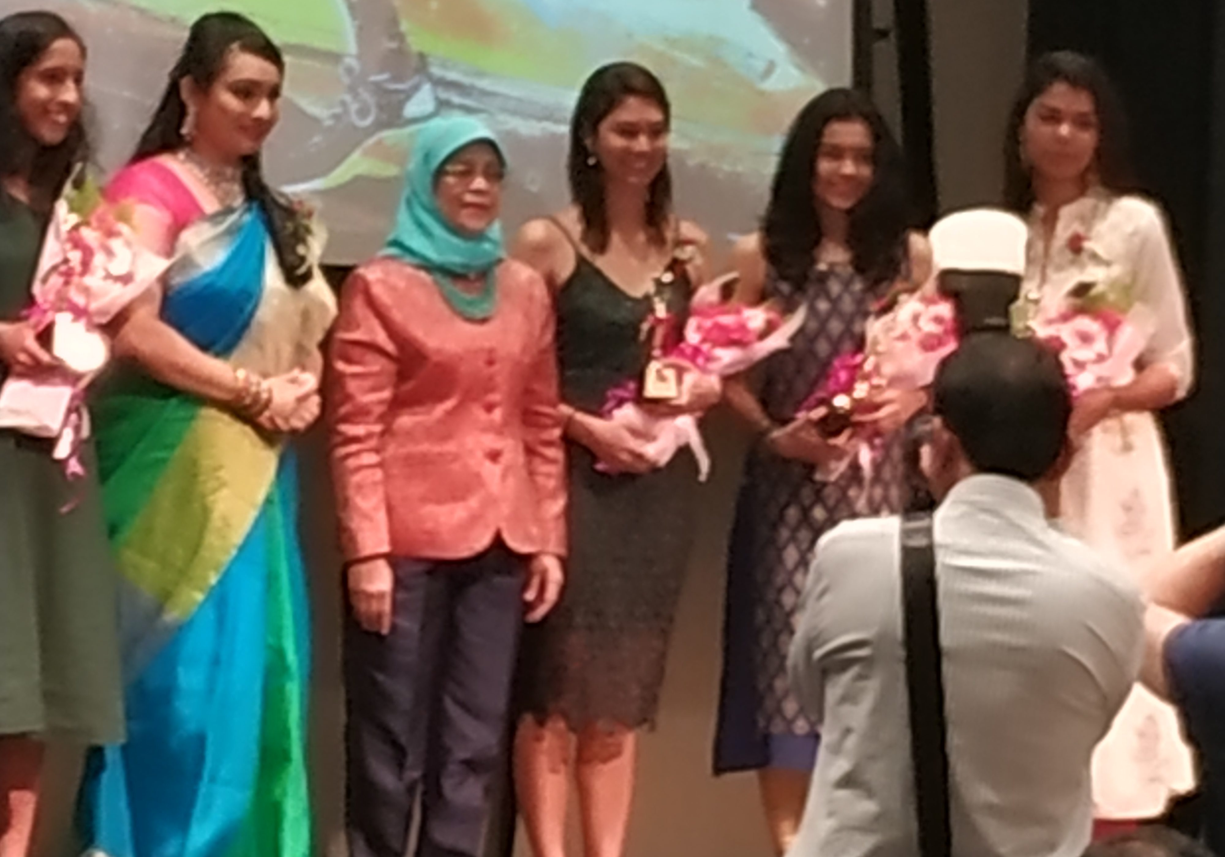 President Halimah Yacob (third from left) with Ms Joyce Kinsgly, second from left, and award winners